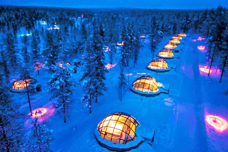 The Igloo Village of Hotel Kakslauttanen in Finland boasts 20 thermal glass igloos that allow visitors to enjoy incredible views of the Aurora Borealis from the warmth and comfort of their own geodesic hut.