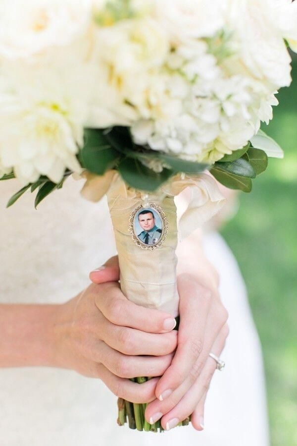 Her father passed away so a picture of him was embedded onto the boquet so he can still walk her down the aisle