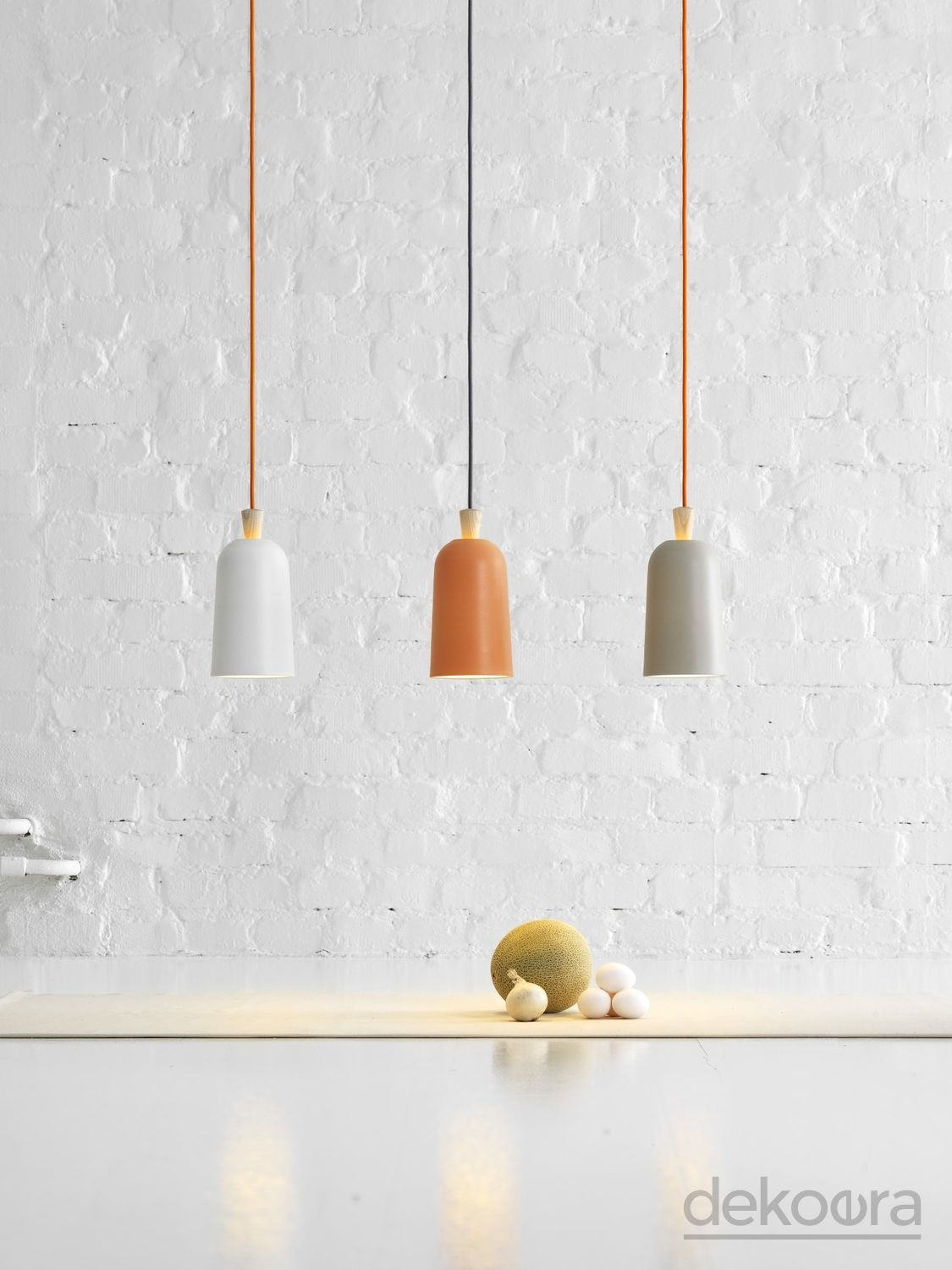 Soft porcelain pendant lamp with a wooden fuse ready to