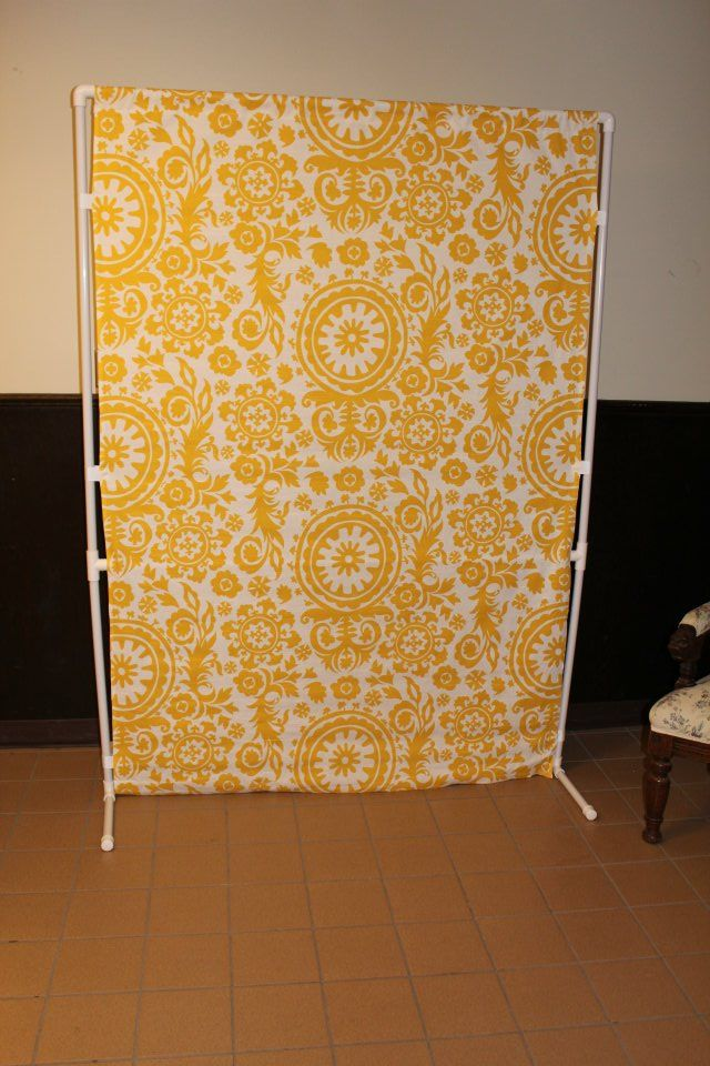 Use A Garment Rack Stand And Attach Pattered Fabric With