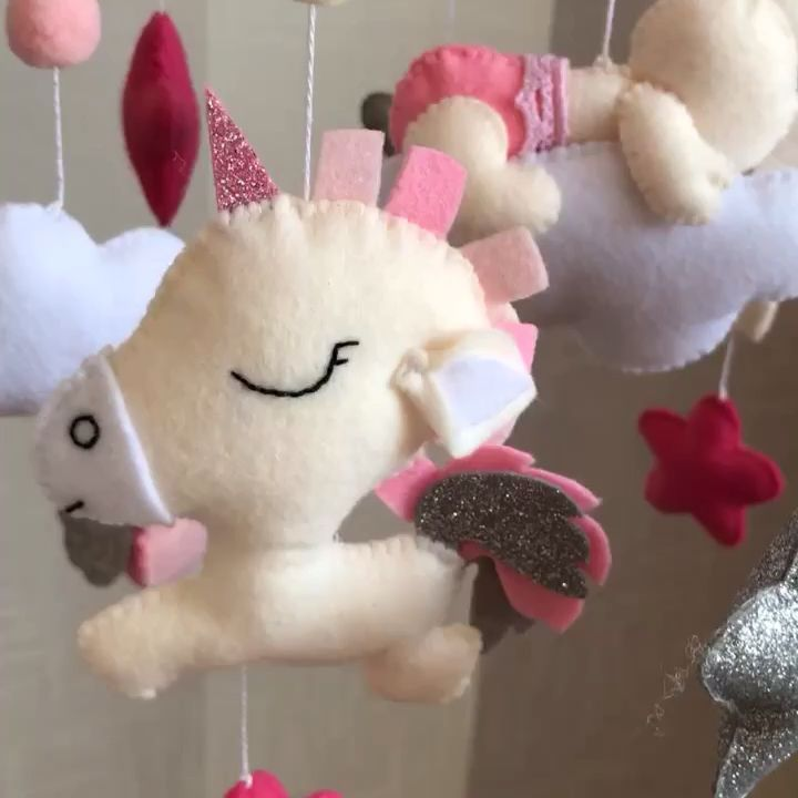 Photo of Pink baby girl mobile with unicorn and forest animals