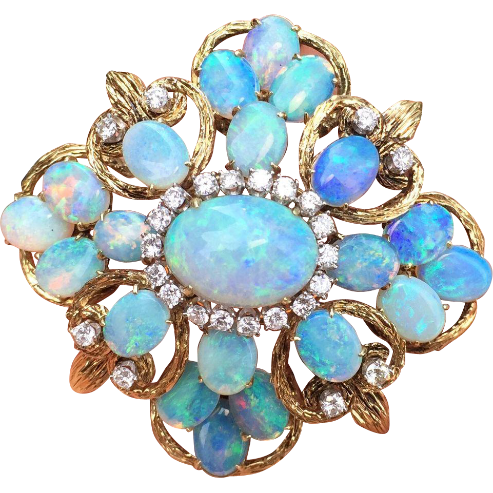 A dramatic vintage opal cluster and diamond brooch and pendant that