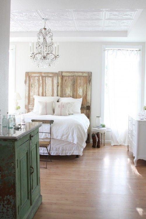 white bedroom, old doors as headboard