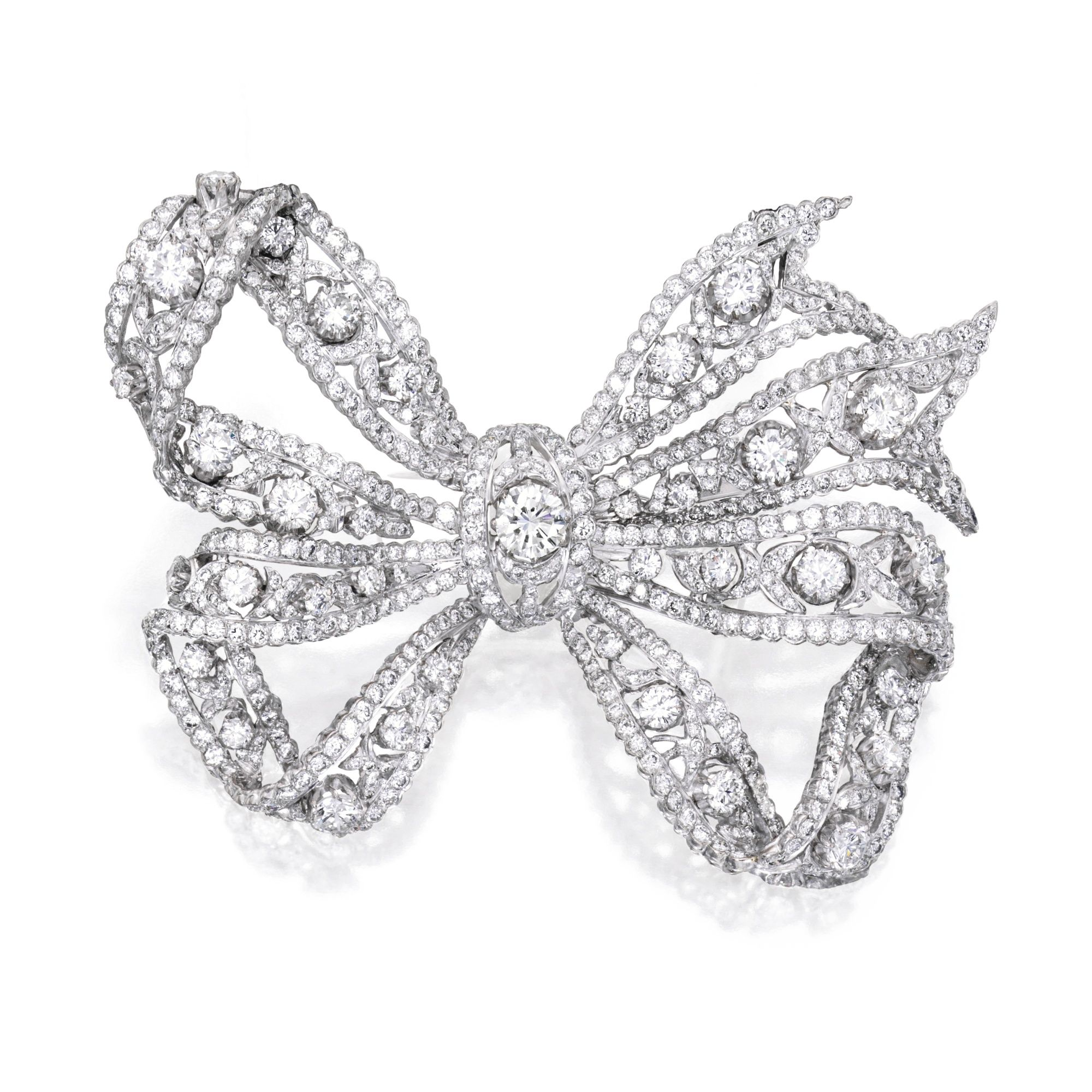 18 KARAT WHITE GOLD AND DIAMOND BROOCH Designed as an openwork bow, centered by a round diamond weighing approximately 1.40 carats, further set with numerous round, rose and single-cut diamonds weighing approximately 19.45 carats