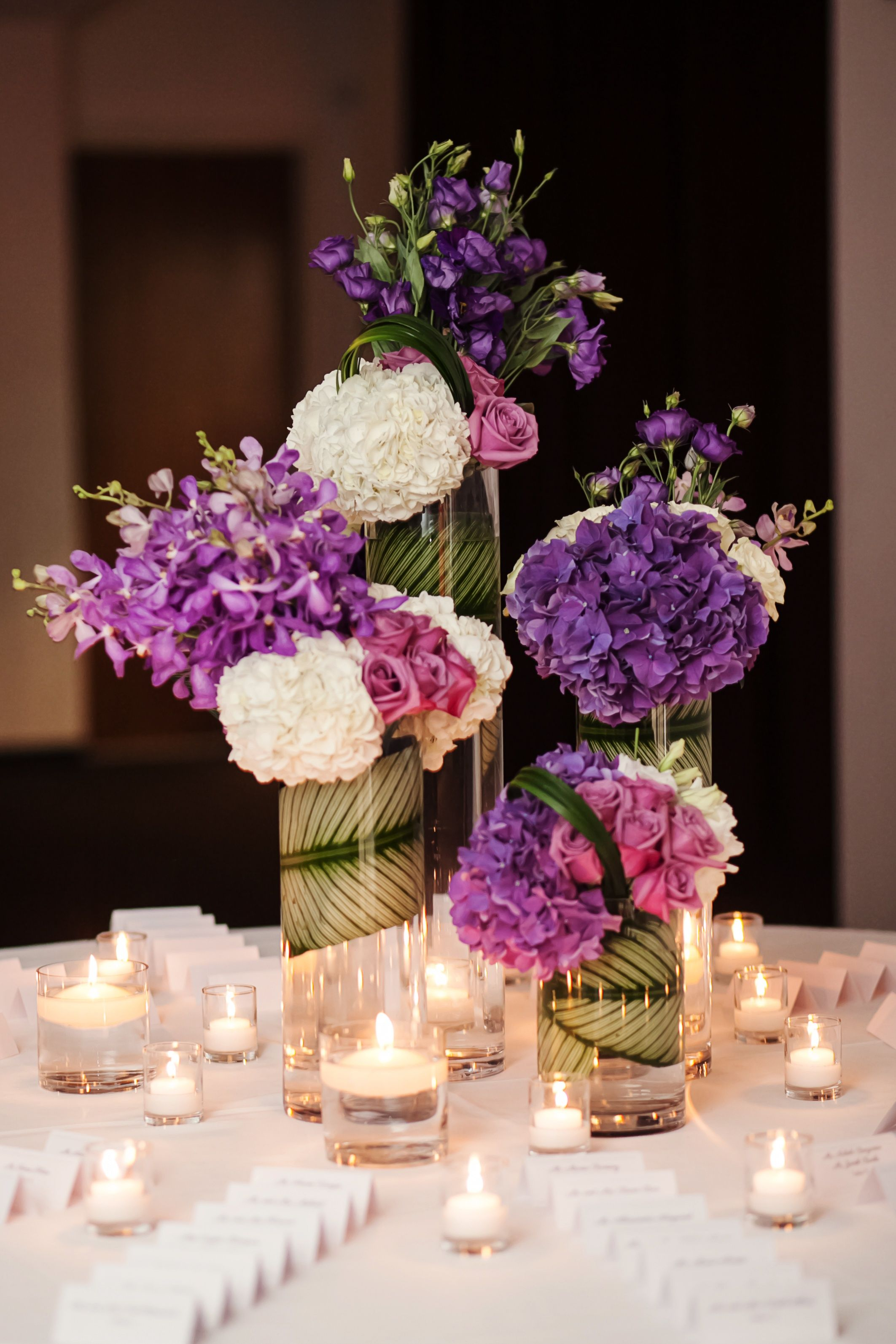 White And Purple Centerpieces Jayd Gardina Photography Theknot