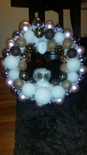 Owl wreath made by me♡ I added some animal print to it because my 2 faves are animal prints and owls... I also added an acorn jingle bell at the top.