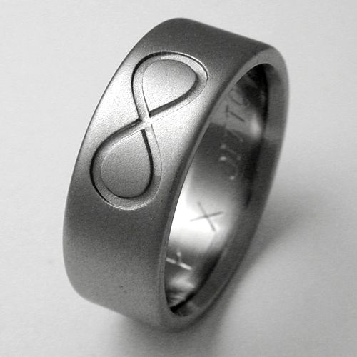 Ellicott titanium ring with infinity symbols Titanium wedding