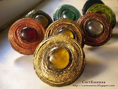 all things paper: Paper Jewelry from Cartessenza Do a paper roll and add a stone pebble. Crackling the stone first in hot water, then in iced water would be lovely.