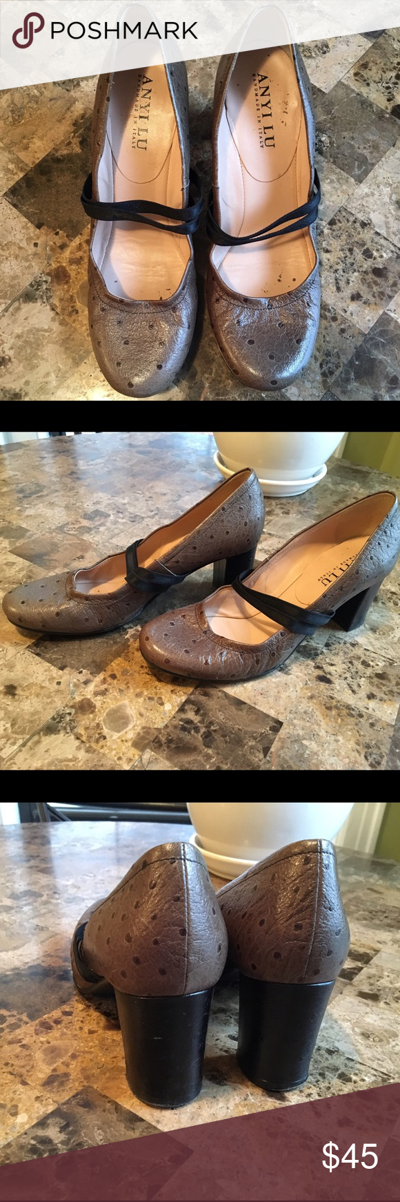 Anyi Lu handmade in Italy leather pumps. These are handmade by Italian shoe maker and perfect for work. They are in great preowned conditions and super comfortable.  authentic leather. NOTE they run at least one size small. My shoe size is 8 1/2 - 9 and they fit perfectly. Shoes Heels