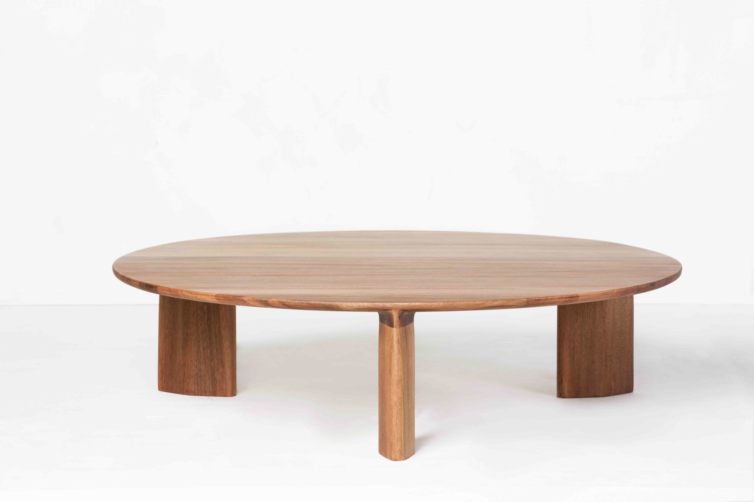 Large Wood Coffee Table To Contrast The Other Materials In The Living Room