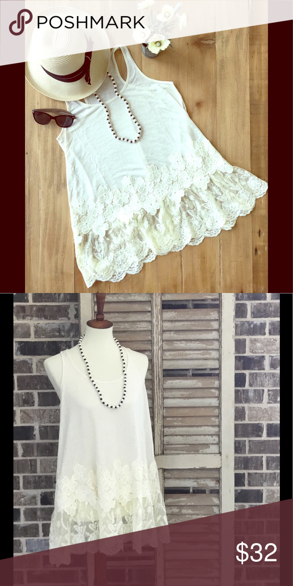 Sleeveless Racerback Floral Lace Tunic This cream racerback tunic has a floral trim bottom hem. Perfect for those hot summer outings! Umgee Tops Tank Tops