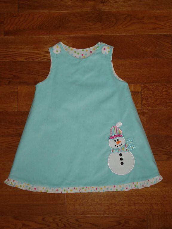 Pattern: Children's Corner, Lucy in corduroy with snowman applique.