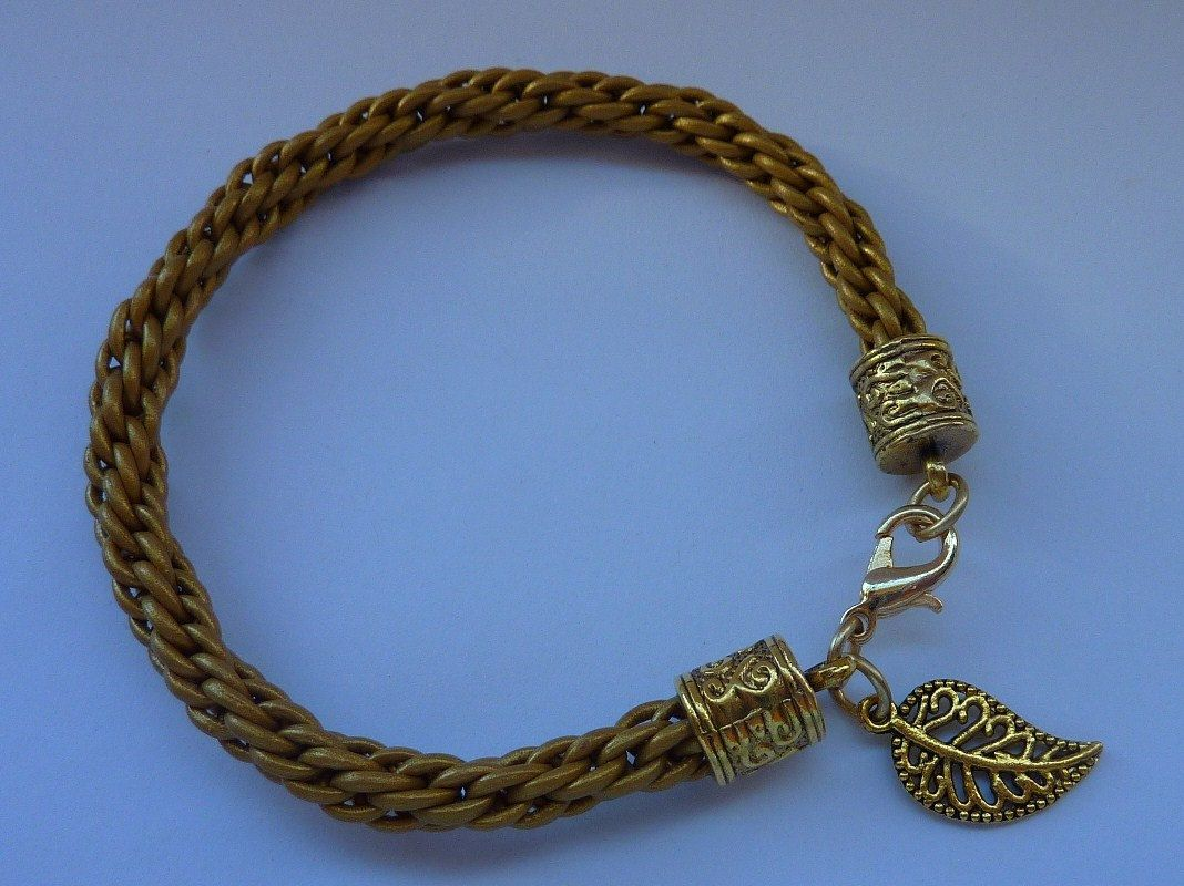 Leather Kumihimo Bracelet: Old Gold braided leather bracelet with Tibetan Gold ends for gift of love and friendship. £9.00, via Etsy.