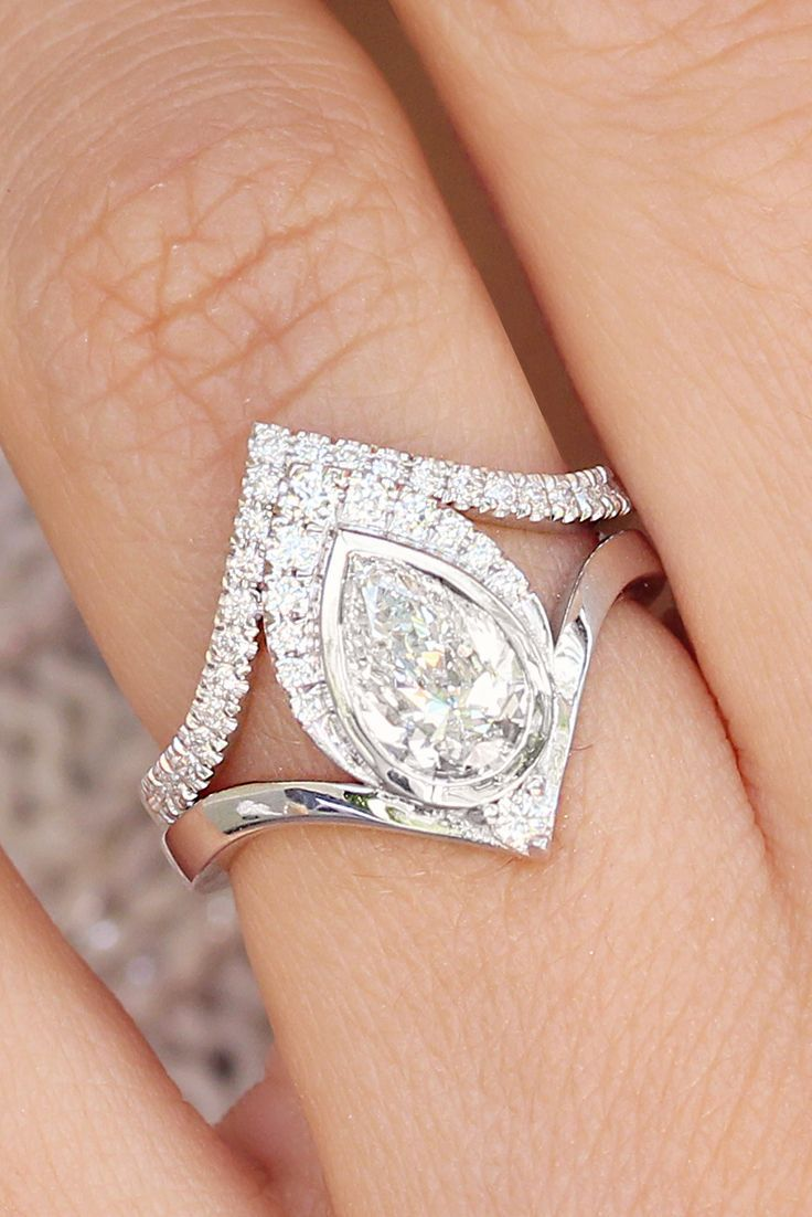Pear diamond carat engagement ring with v matching diamond