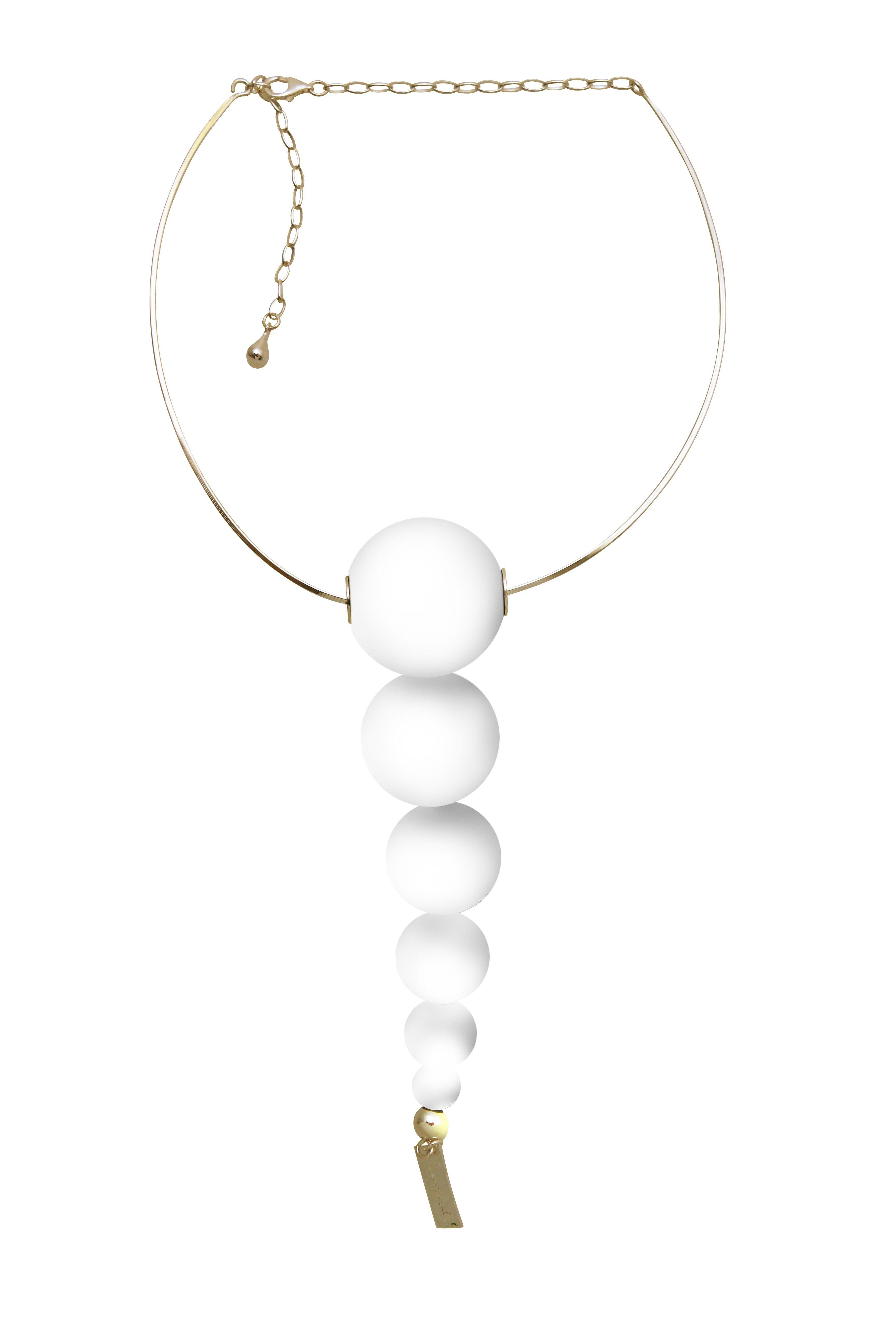 White tie necklace from Langaeble Stockholm. #langaeble #nordicdesigncollective #swedishdesign #swedishfashion #statementjewelry #statement #minimalist #whitejewelry #white #brass #cool #fashionforward #unique #accessories #smycken #svenskasmycken #wood #details #design #nordicdesign #necklace #halsband