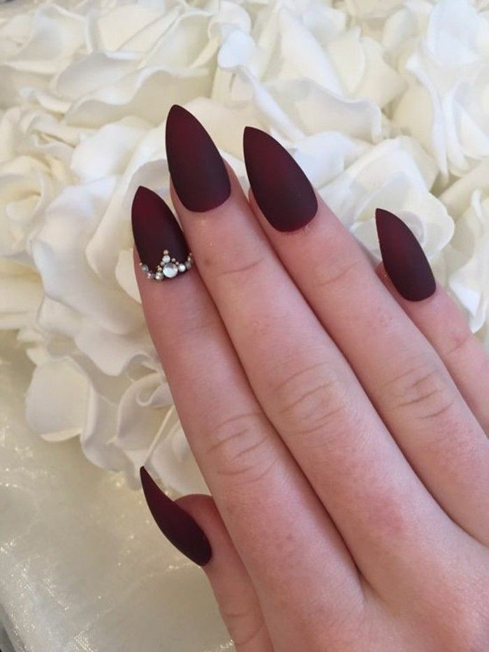 nail designs with rhinestones and glitter, hand with sharp nails painted  with deep red matte polish, one nail decorated with several rhinestones - ▷1001 + Ideas For Nails With Rhinestones You Must Try This Year