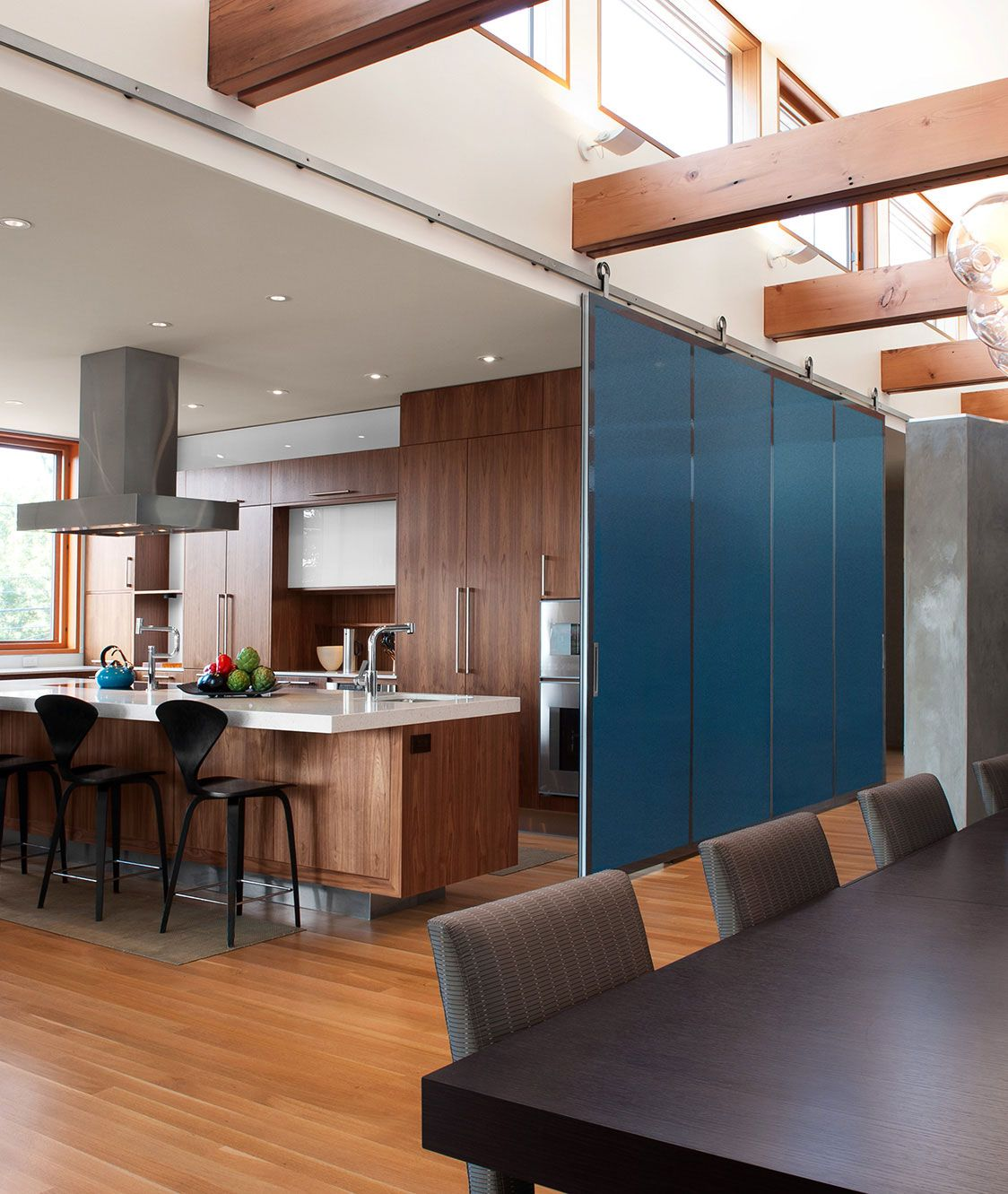 Krownlabs BALDUR Stainless Steel Top Mount Sliding Barn Door Hardware Is Used In This Modern Residence To Hold A Panel Between The Kitchen And Dining Room
