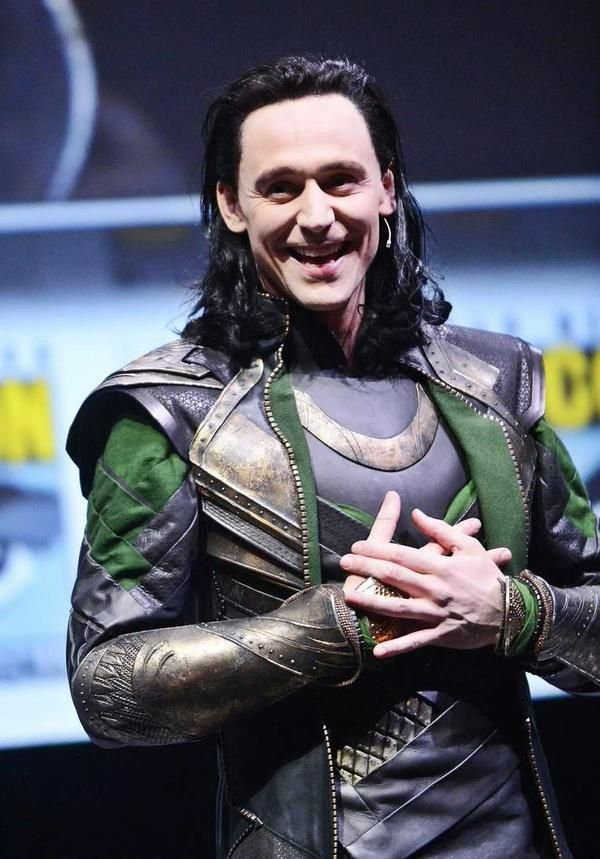 Smiley Loki! Tom Hiddleston in his Loki stunt at Hall H, San Diego Comic-Con, to promote 'Thor: The Dark World' (2013). Credit: Getty Images.