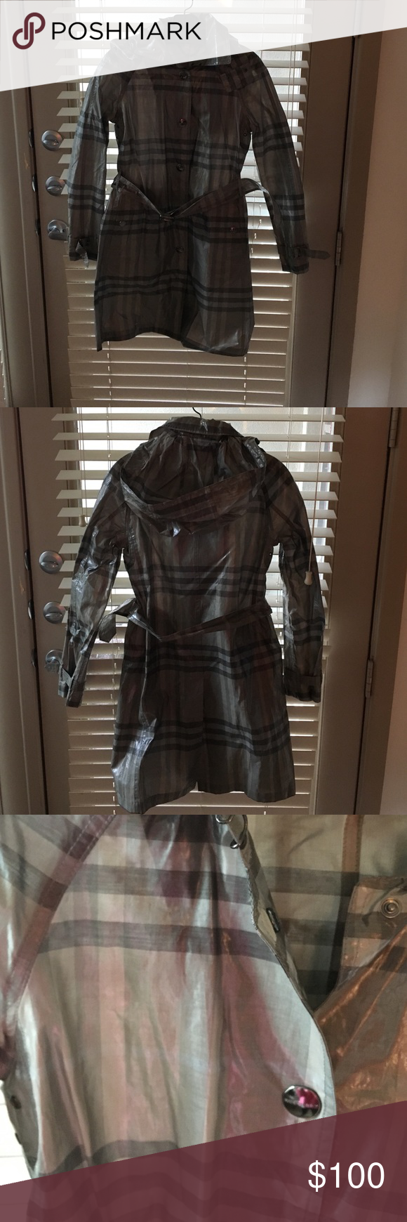 Authentic Burberry rain jacket!! Gray! Size 2 Rain jacket 74% cotton and 36% silk. Gary and rain proof size 2. Worn twice!! Burberry Jackets & Coats Utility Jackets