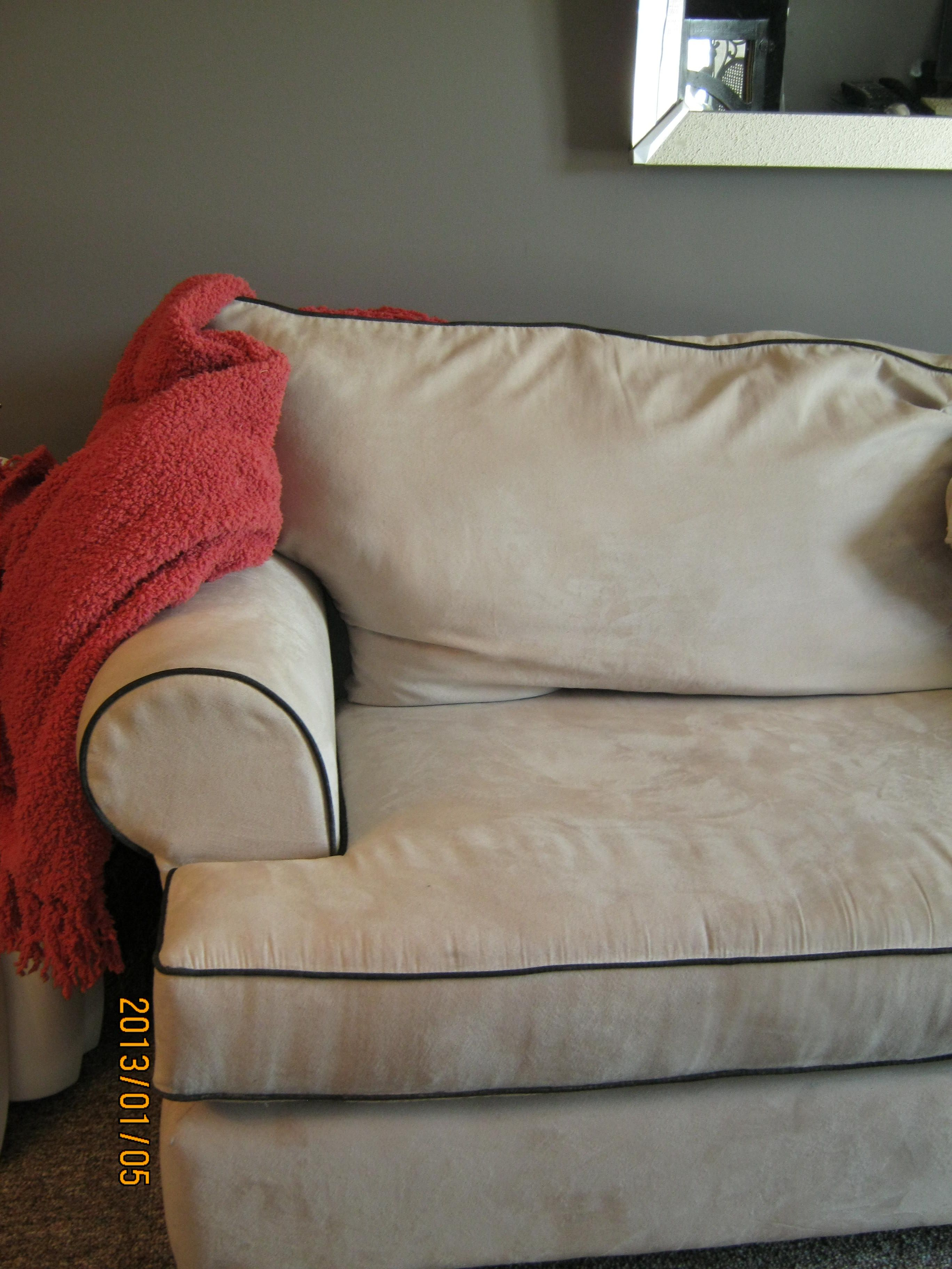 Regular beige sofa coloured the piping black using fabric pen for