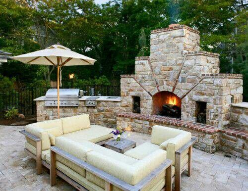 Outdoor fireplace .....sweet!