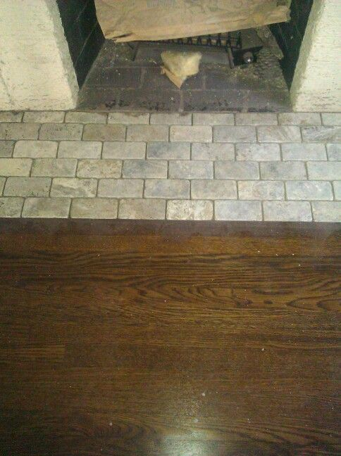 stone tile in front of fireplace
