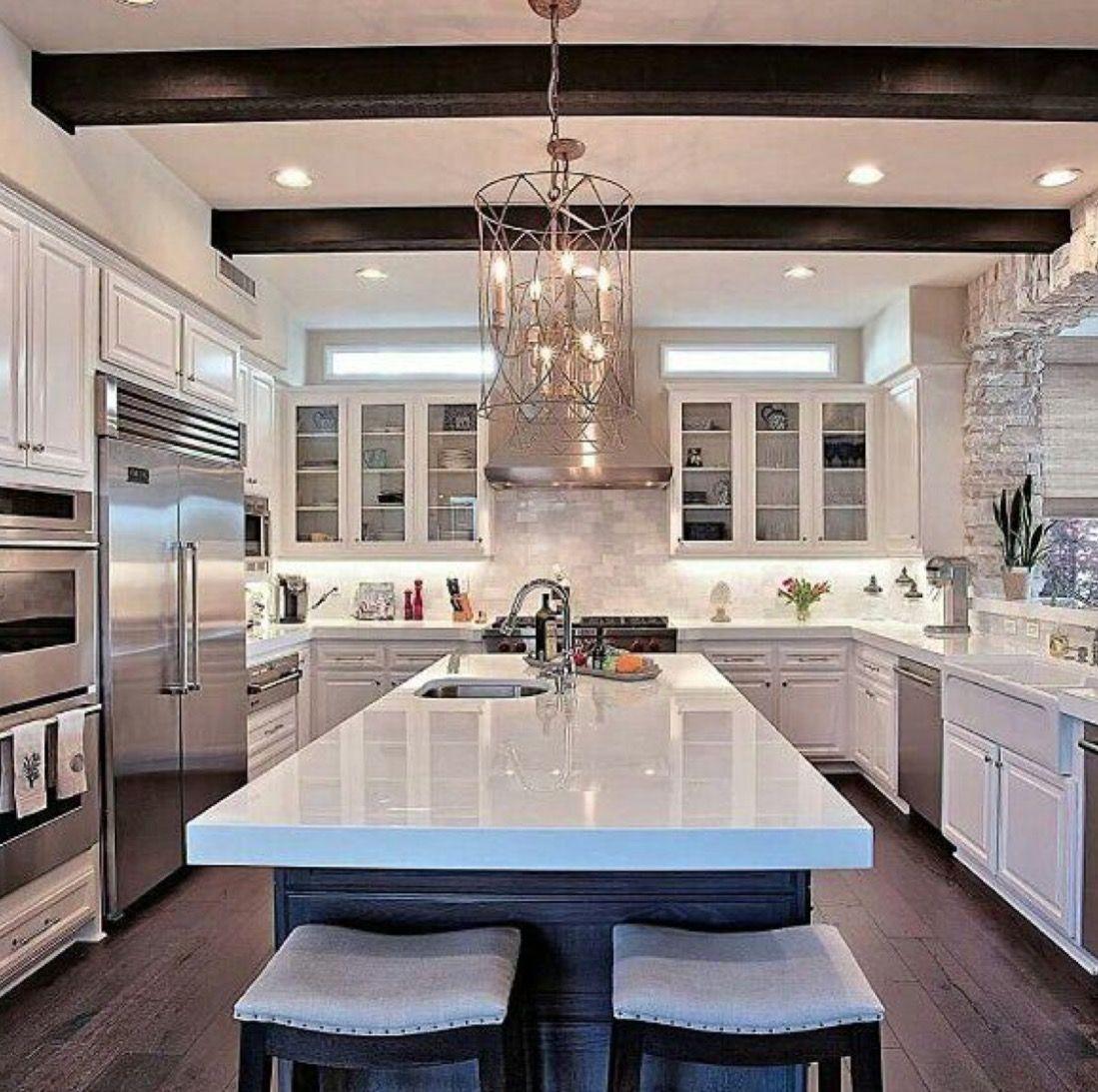 Large, spacious white open kitchen with white granite
