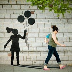 Katie Sokoler cut out human forms from black paper. She taped them onto the walls and sidewalks around Brooklyn.She then waited for people to walk by and took a picture at the exact moment they matched up with the shadow.