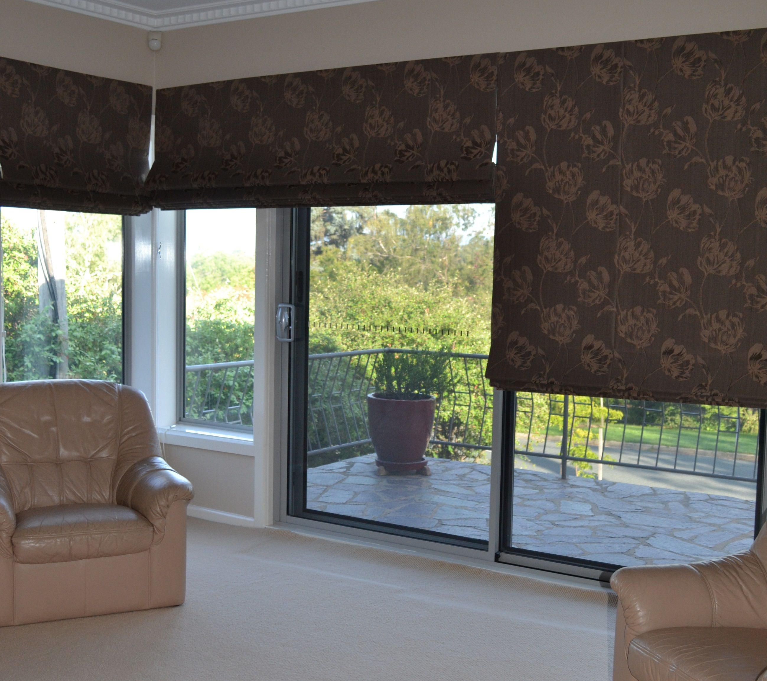 roman blinds over sliding doors