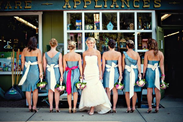Love the idea of having the maid of honor wearing a different color sash