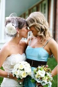 I want the dress, hair, flower and veil!  So gorgeous.