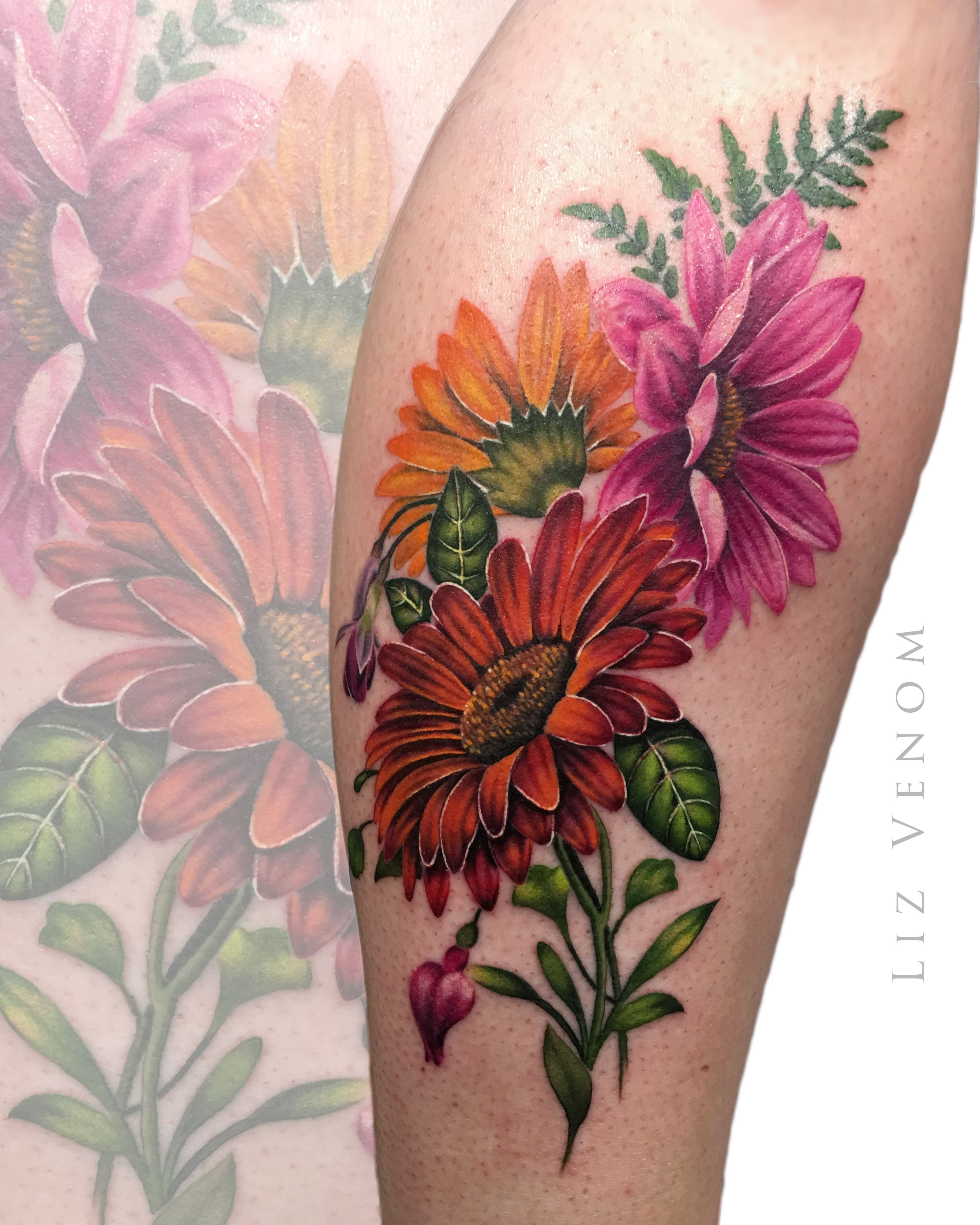 beautiful vintage botanical inspired gerber daisy tattoo