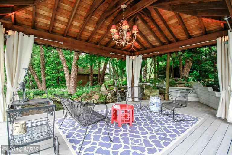 Fancy covered patio with cute chandelier. | Patio ... on Fancy Outdoor Living id=84609