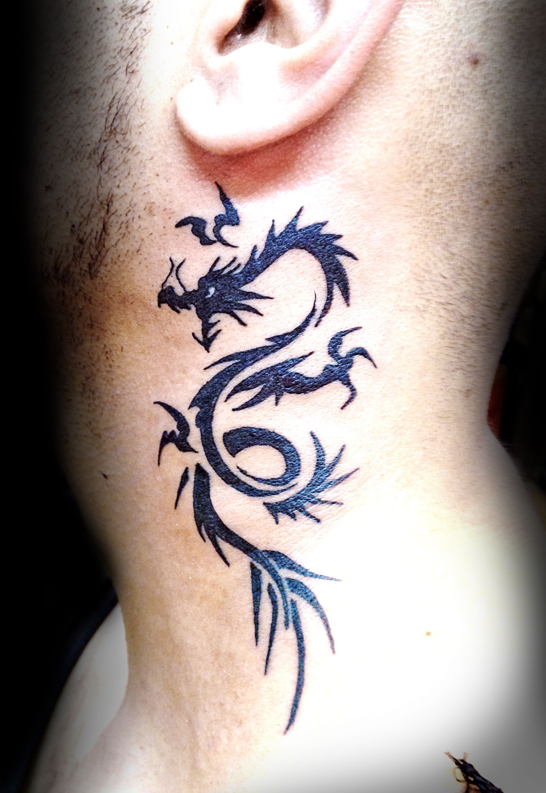 Tribal dragon neck tattoo by Jenny Forth, Miami Neck