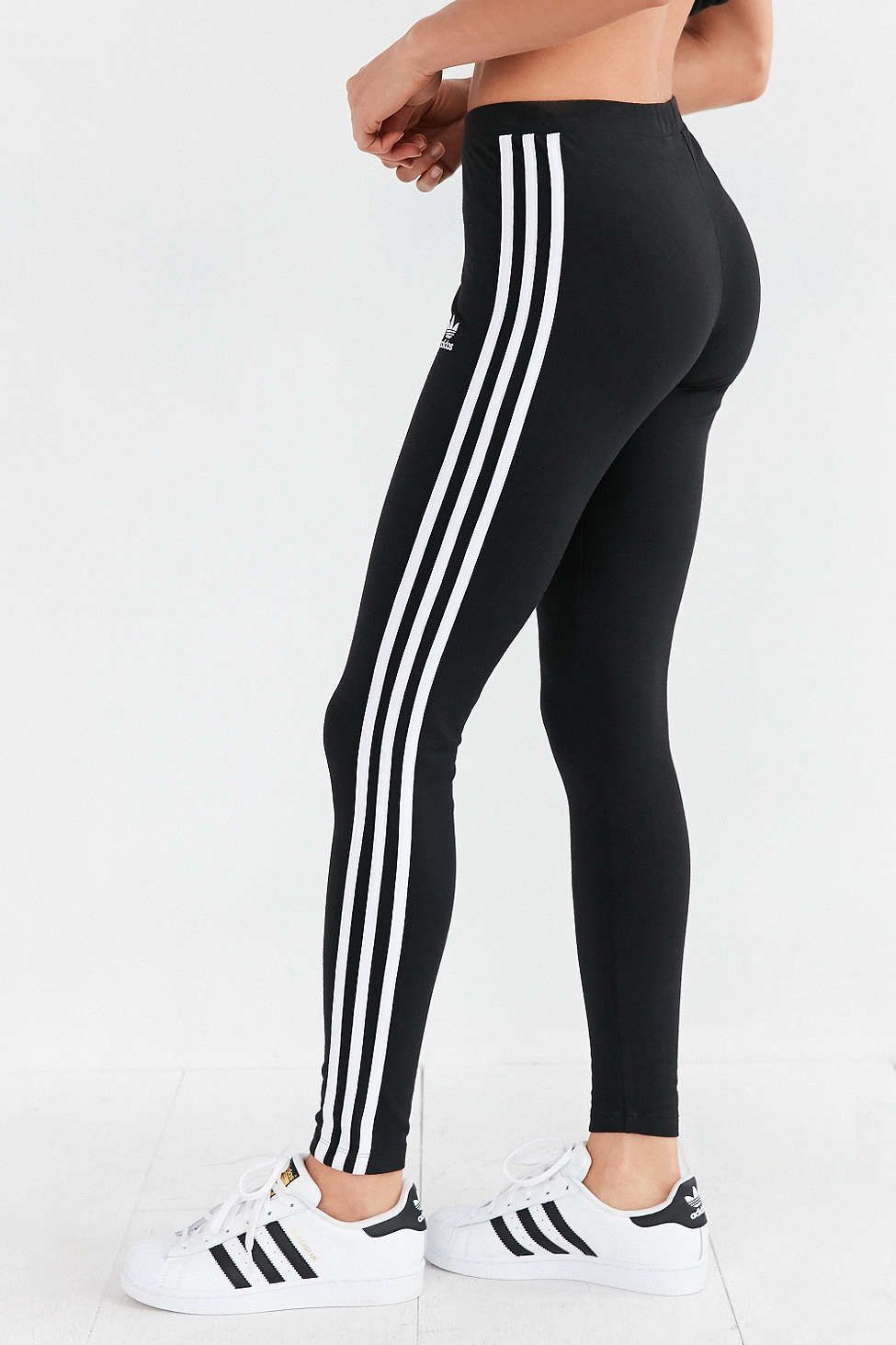 8b4a559293617 adidas Originals 3 Stripes Legging - Urban Outfitters Striped Pants,  Leggings, Stuff To Buy