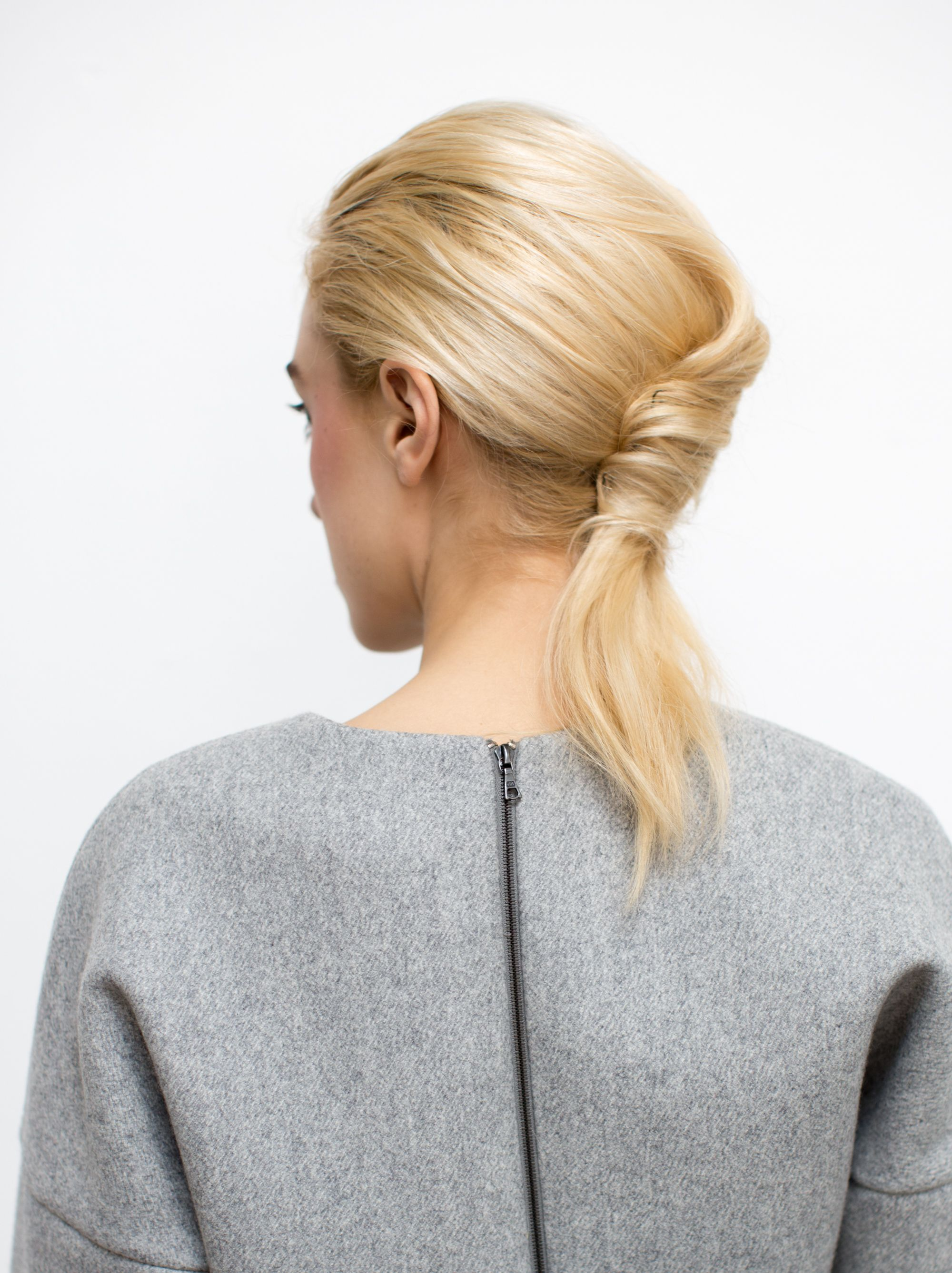 """Bb. Stylist Allen created this """"ponytail/French twist hybrid"""" for Rosie Assoulin's Fall/Winter 2014 show. The inspiration for this style was to mimic the look of hair that had been tucked into a coat. #bumbleandbumble #BbBackstage #hair #ponytail #frenchtwist #fashionweek #NYFW #FW2014 #rosieassoulin"""