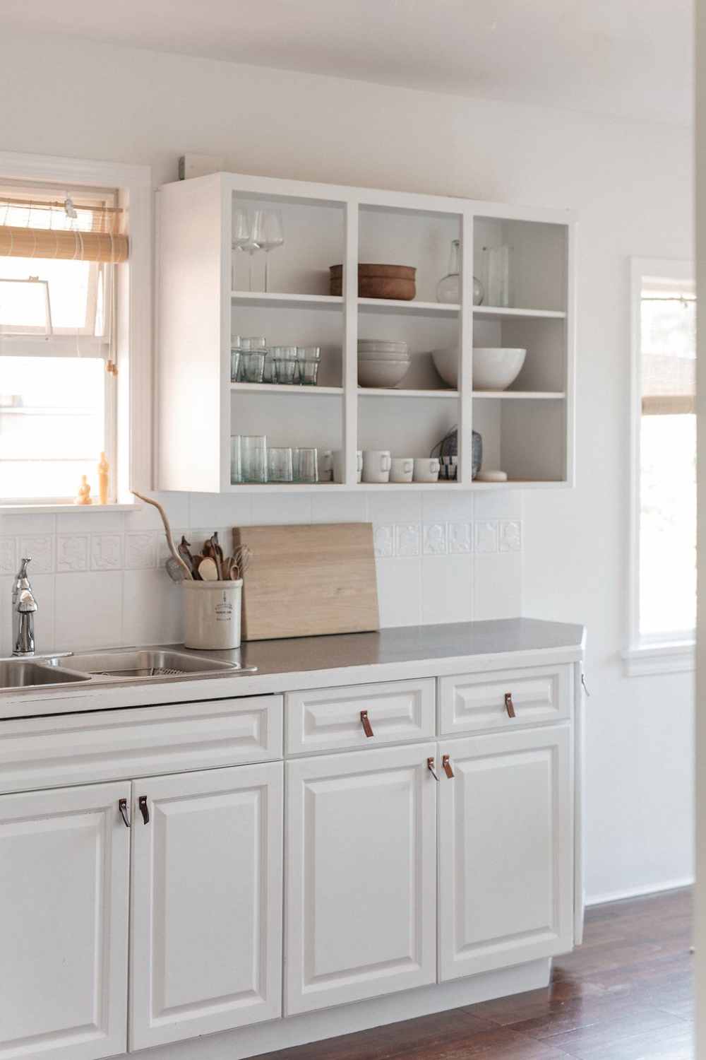 Pale And Interesting An Artful And Economical Renovation In Vancouver Bc Remodelista In 2020 Upper Kitchen Cabinets Open Kitchen Cabinets Kitchen Cabinets