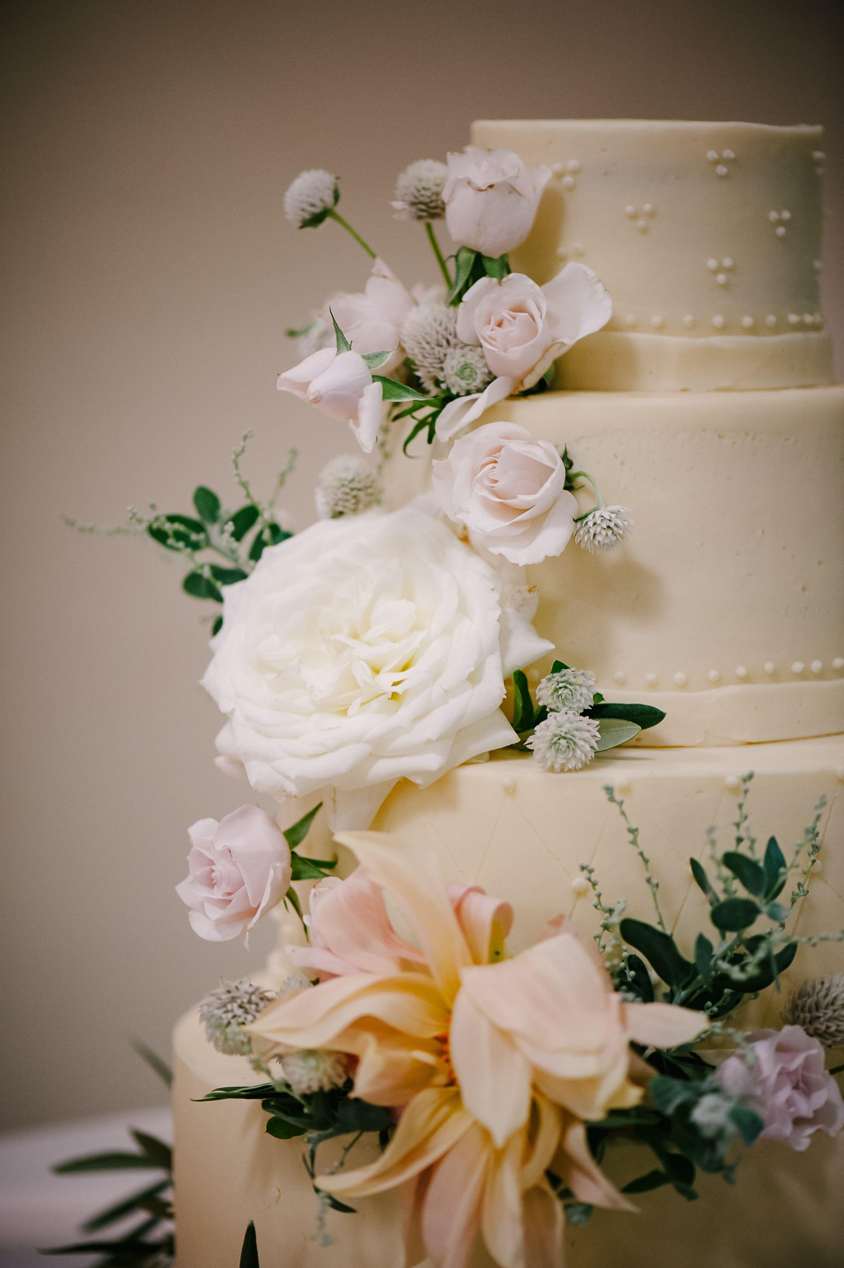 White Peach Blush Pink And Dark Greenery On Wedding Cake By