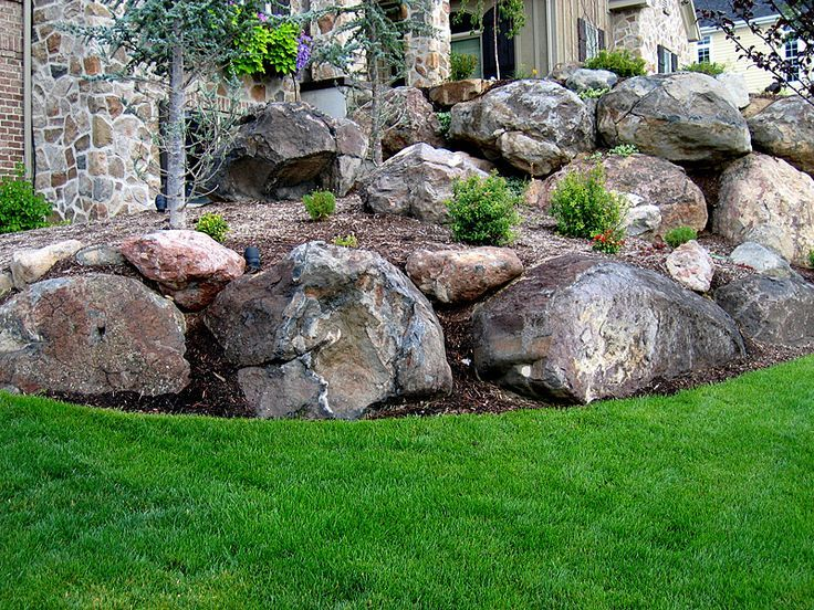 Images boulder retaining walls bing images barns for Rock wall garden