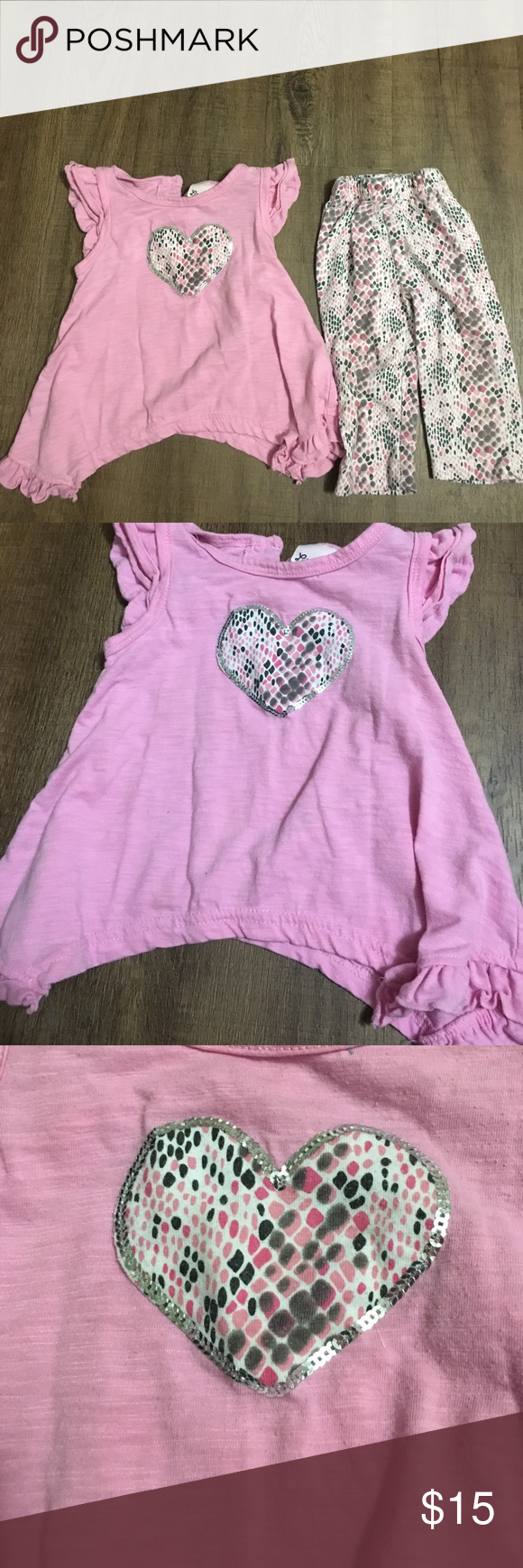 Pink snakeskin pattern outfit Pink short sleeve top with heart lined in silver sequins. White pants with pink black gray pattern. Looks like snakeskin. Very cute. 18 months. The shirt has frilly shoulders and its frilly on the bottom. Little Lass Matching Sets