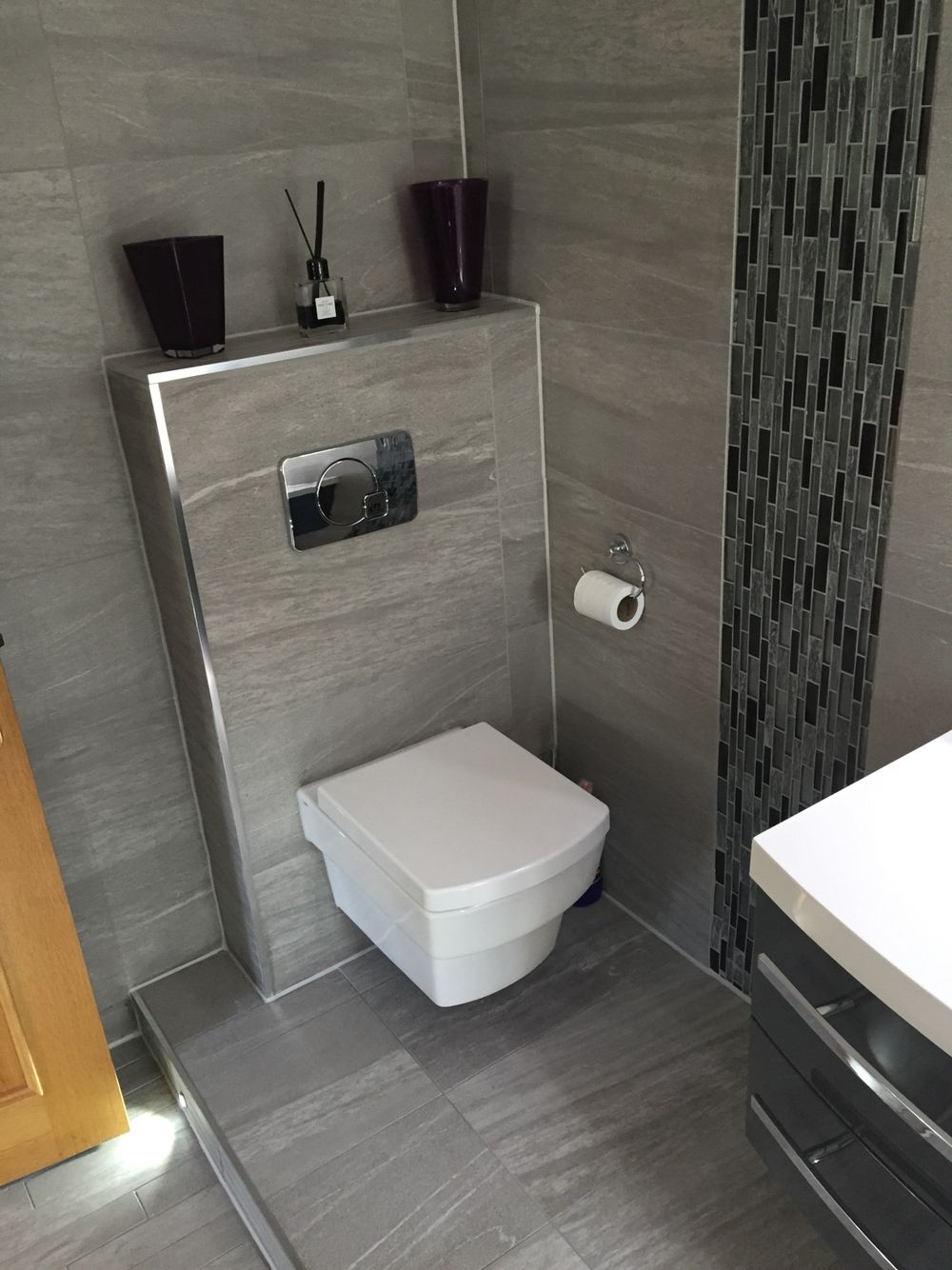 Wall Hung Toilet Pan Raised Flooring Into The Room With