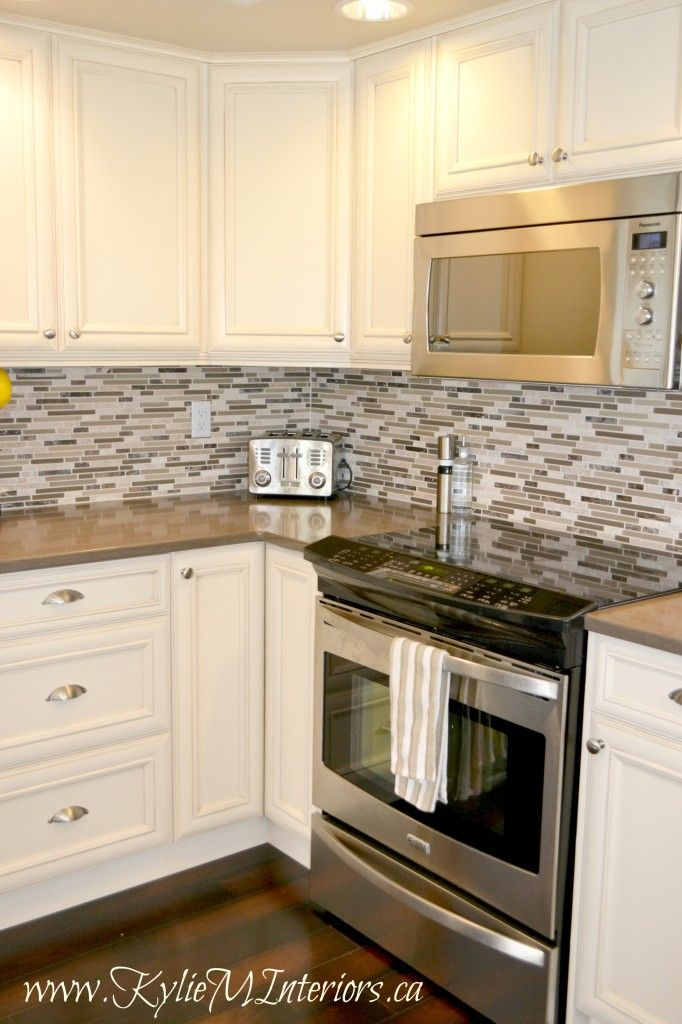 Kitchen Remodel Cream Glazed Cabinets With Mosaic Tile Backsplash And Dark Wood Floors Kitchen Remodel Small Oak Kitchen Remodel Kitchen Remodeling Projects