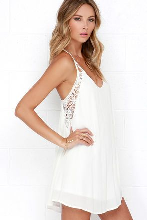 The Spirited Ivory Lace Dress will let your lovely nature shine through! Pierced lace shapes straps above a woven rayon swing dress, beginning at a scoop neckline. Panels of floral lace frame the bodice in low side cutouts and create a racerback. Wide-cut silhouette flows to a cute, and flirty length.