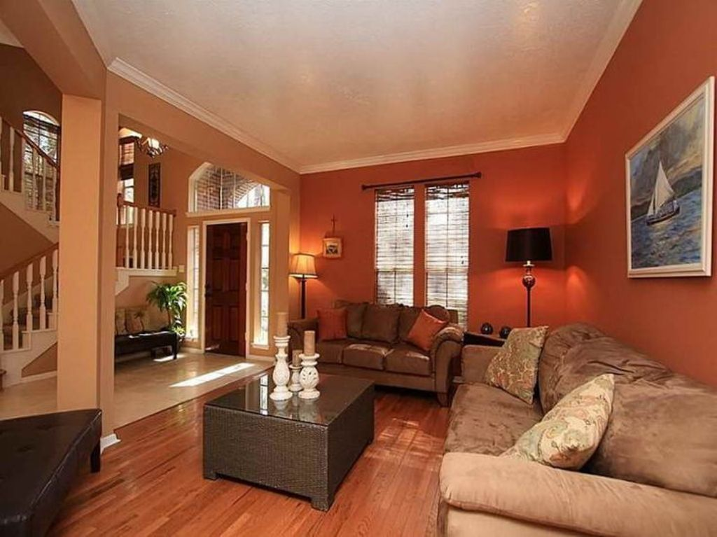 Deep orange wall color with velvet beige sofa set for - Interior paint ideas for small rooms ...