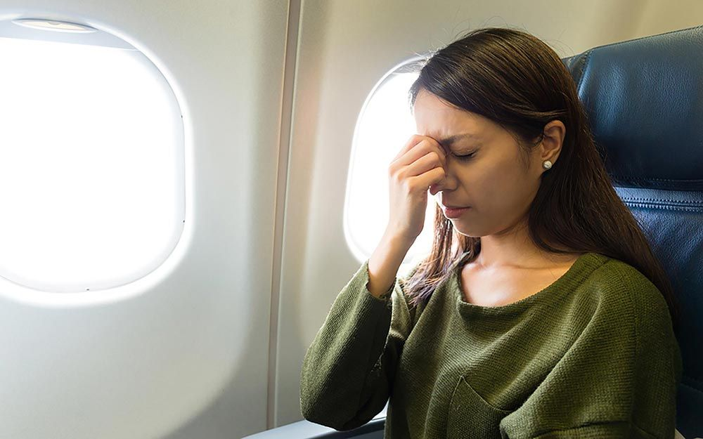 10 Smart Tricks to Avoid Getting Sick on Long Flights