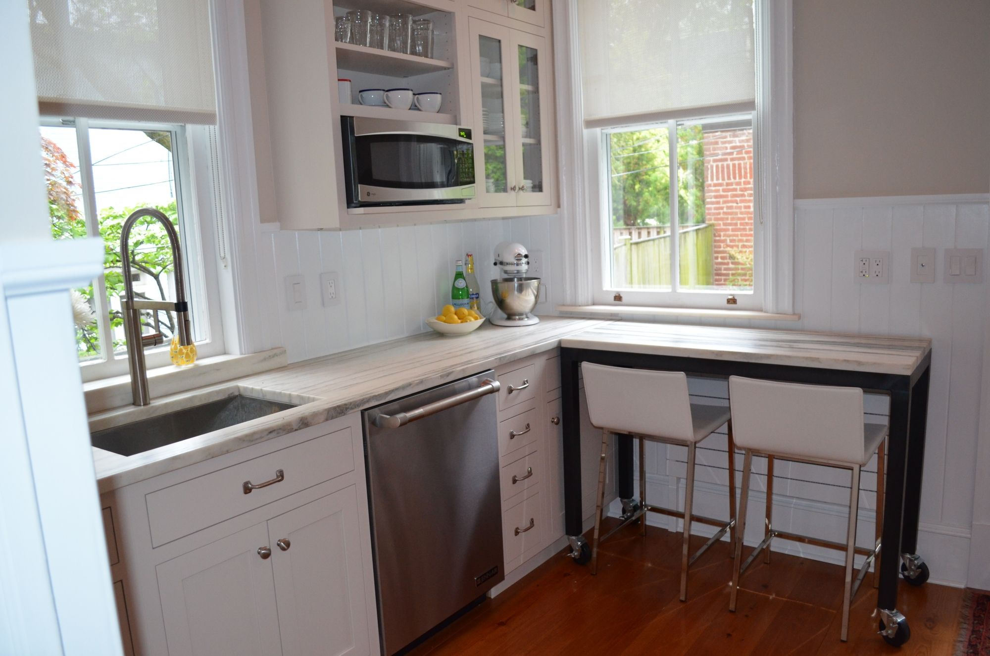 This compact kitchen is just over 100 SF and designed to ...