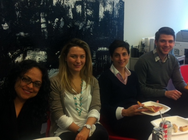 More smiling faces during the New York office pizza lunch