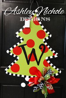 "Deck your halls with a personalized, fun, and colorful wooden Christmas tree door decoration! This tree is hand cut and hand painted with you in mind. You can make it your own by adding a monogram of your choice. This item makes a great gift and is good for indoor and outdoor use. Made of 1/4 thick wood, painted with high quality outdoor paint and painted on the back for a polished look. 32"" tall x 23""wide"