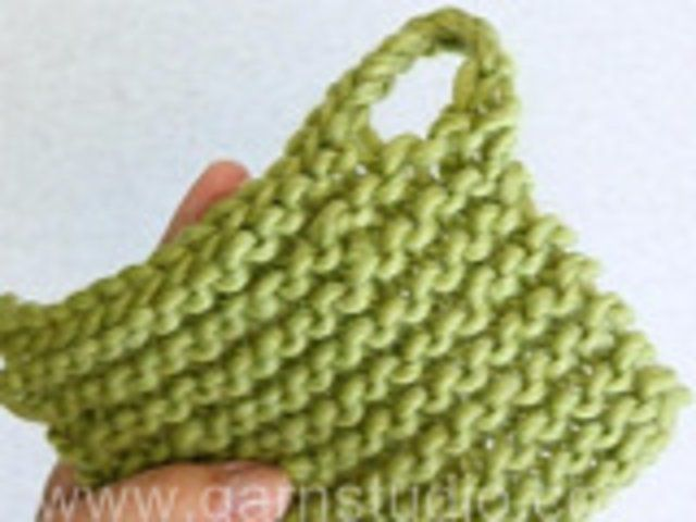 DROPS Knitting Tutorial: How to knit a built in Loop. In this DROPS video we show how to  knit a built in Loop.  Every knitted potholder, wa...