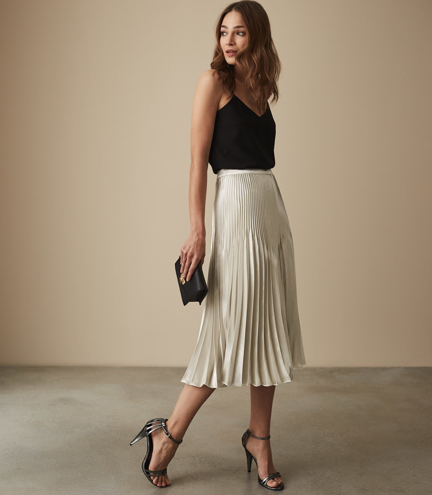 23997dc007 Isidora Knife Pleat Skirt - REISS : The isidora knife pleat skirt in plays  its part